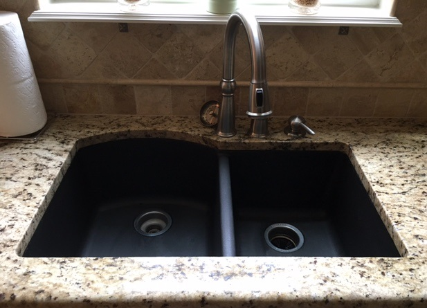 White Marks On A Black Granite Sink
